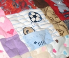 Pieced baby clothing quilt